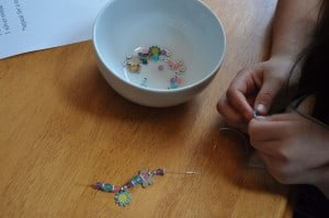 making the bracelet 300x199 Great 7 Year Old Girl Birthday Party Idea: Tea and Craft Party!