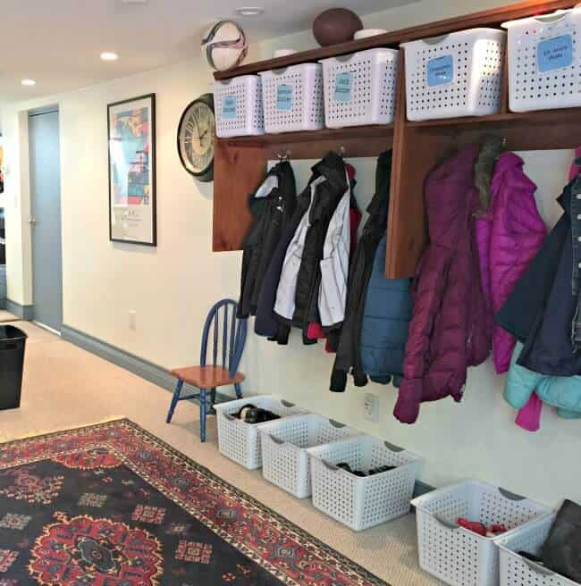 In a perfect world, every home would have a space dedicated as a mudroom- a place to store coats, shoes, and everything you need before you head out the door. But many homes don't have such a dedicated space- so here's how to create a mudroom space in a room that is already dedicated for another purpose! #Spon
